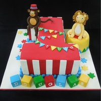 1St Birthday Circus Themed. Mud cake with Ganache and fondant finish. Handmade fondant circus animals.