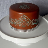 Chocolate Stencilled Cake This is my first ever time stencilling on a cake, also my first time using and making chocolate mmf. Cake is chocolate sponge with...