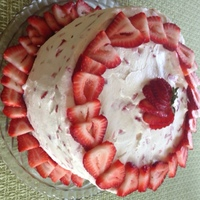 Strawberry Cream Birthday Cake Three layer dense yellow cake frosted with whipped cream mixed with cream cheese, sugar, and diced fresh strawberries. TFL!