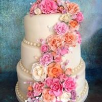 Summer Wedding Vanilla sponge and fruit cakes. Covered in fondant with hand made flower paste roses and filler flowers