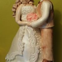 Bride And Groom Cake Topper  Bride and Groom cake topper. The lower parts of both are pastillage, the torso and clothing are then modelling paste. This was created for...