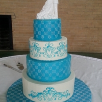 Wedding Cake   White French Vanilla cake with raspberry filling and buttercream frosting. Stenciled with buttercream.