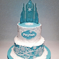 Frozen Cake With Isomalt Castle Birthday cake for my 6-year old granddaughter. Castle is poured isomalt using a template from Artisan Cake Company. Bottom tier has Cake...