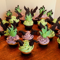 Maleficent Cupcakes  Maleficent cupcakes! 24 cupcakes in vanilla and dark chocolate fudge with rose and green buttercream frosting and custom toppers! Raven...