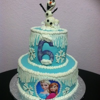Frozen Fondant covered and decorations except for Frozen and Elsa which is a picture. This is a 10 inch with 6 inch on top.