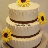 "Sunflower Theme 8"" choc. with strawberry filling 10"" & 12"" vanilla with banana creamButter Cream FinishMy 1st time making sunflower out..."