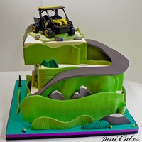 Atv Cake This cake is 3 tiers. Fondant, decorated in modeling chocolate Topper is gumpaste