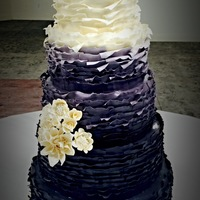 Ombre Ruffles Cake designed for a bride who wanted ombre ruffles and sugar flowers to match her bouquet.