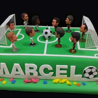 Soccer Cake I made this for my lovely son on his 8th Birthday Party ... It is a soccer match cake between Real Madrid and Barcelona! The kids just love...