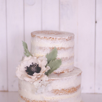 First Love Naked Cake: Lemon and poppy seed cake, swiss buttercream with lemon curd and sugar flower...