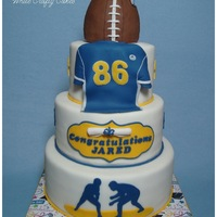 Graduation Cake For A Football Player And Wrestler  I made this cake for the high school graduation of a young man who played football and wrestled. Vanilla chocolate chip cake with...