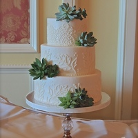 Buttercream Lace Piping With Succulents.   This is all buttercream with simple succulent accents.