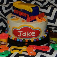 Play Doh   iced in bc, w/ fondant accents on cake. Other were purchased for decorations around cake and cake topper.