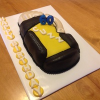 Cuzz Is 60 Wilton retired golf bag cake pan. These shaped pans are so fun. This is a peanut butter cake covered in chocolate buttercream. The...