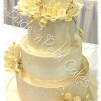 Milla<3 3 tier chocolate mud cake with ivory shimmer, champagne shimmer contrast and gorgeous gum paste roses.
