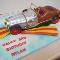 Chitty Chitty Bang Bang Cake An unusual request that I wasn't sure I could do but I pulled it off and was pleased with the results. All edible, covered in fondant...