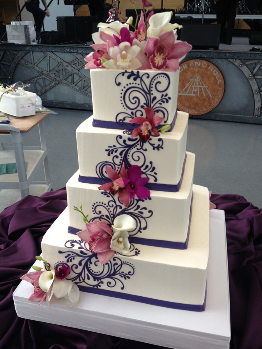 Buttercream Wedding Cake With Scrolling And Fresh Flowers