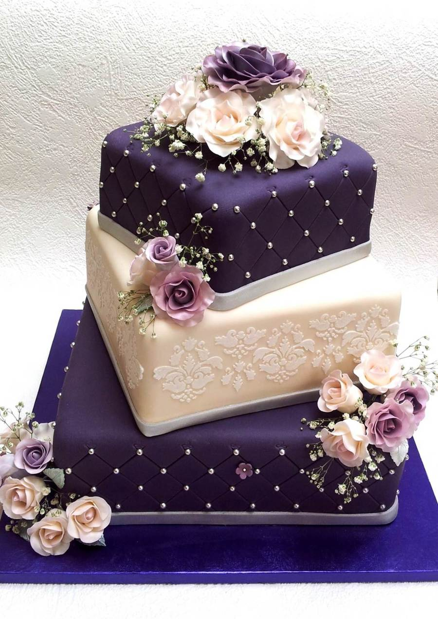 Purple And Cream Wedding Cake With Roses On Central