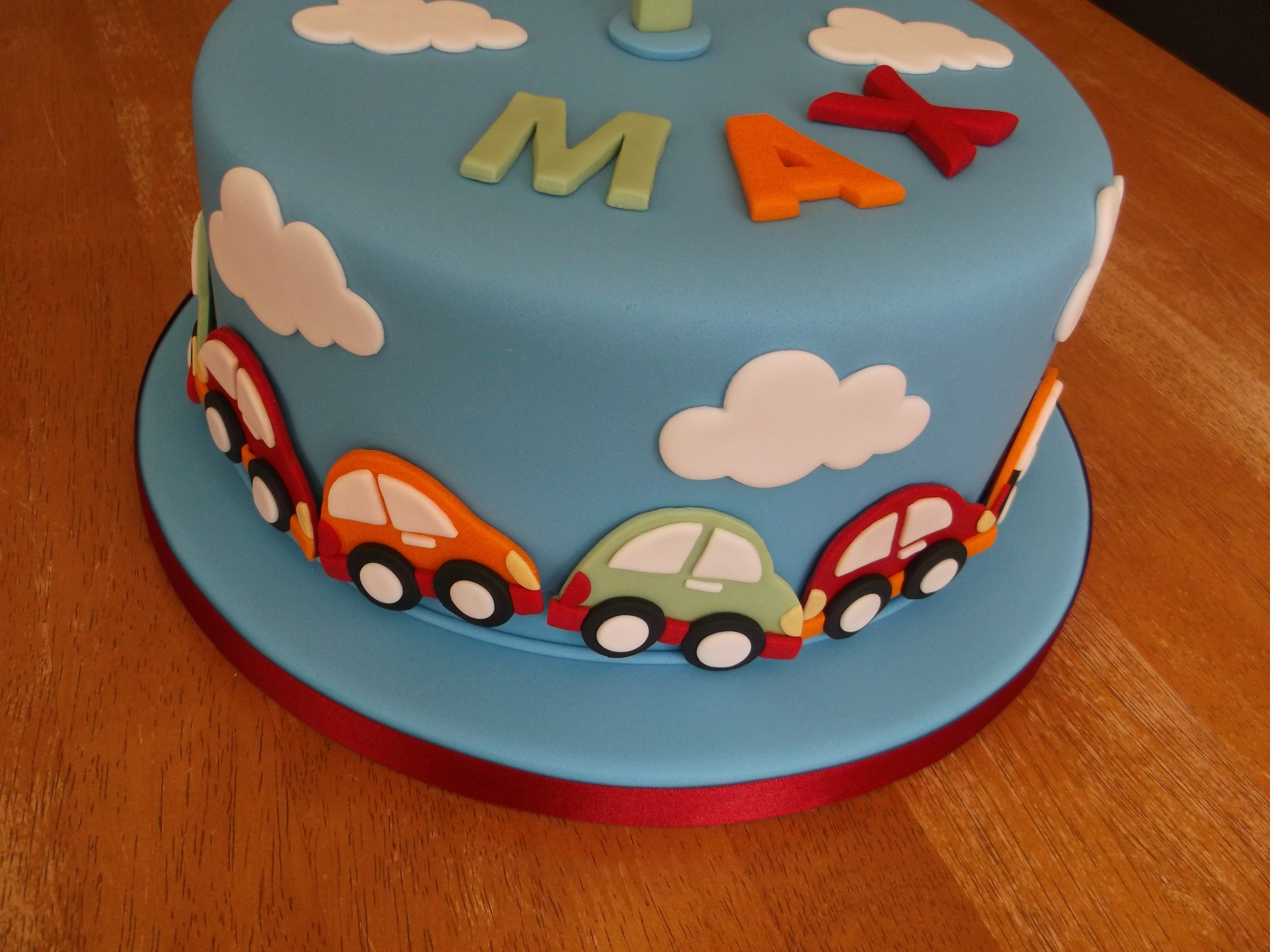 1st Birthday Cake With Cars Around The Bottom Of