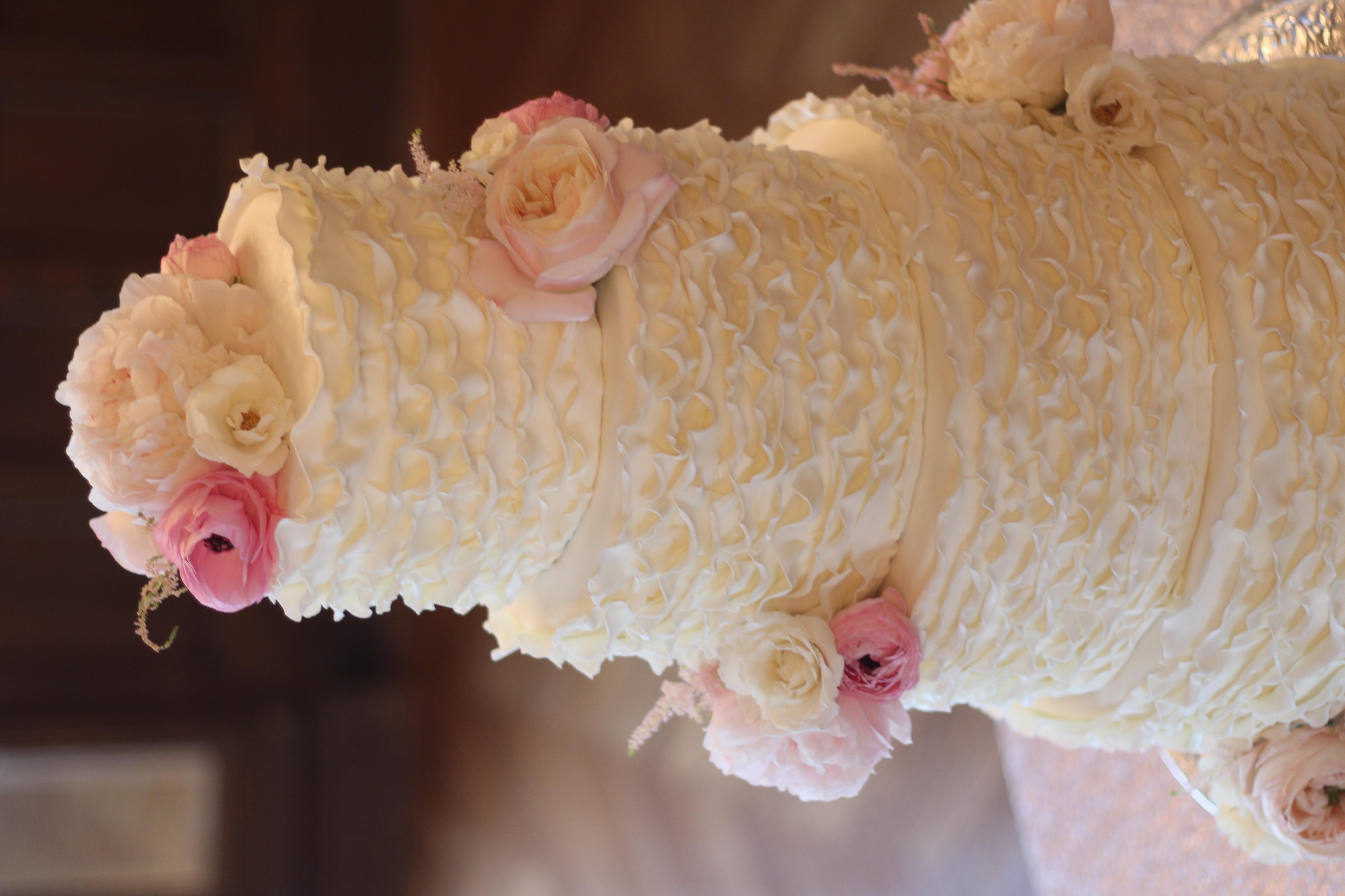 Ivory Elegant Ruffle Four Tier Wedding Cake - CakeCentral.com