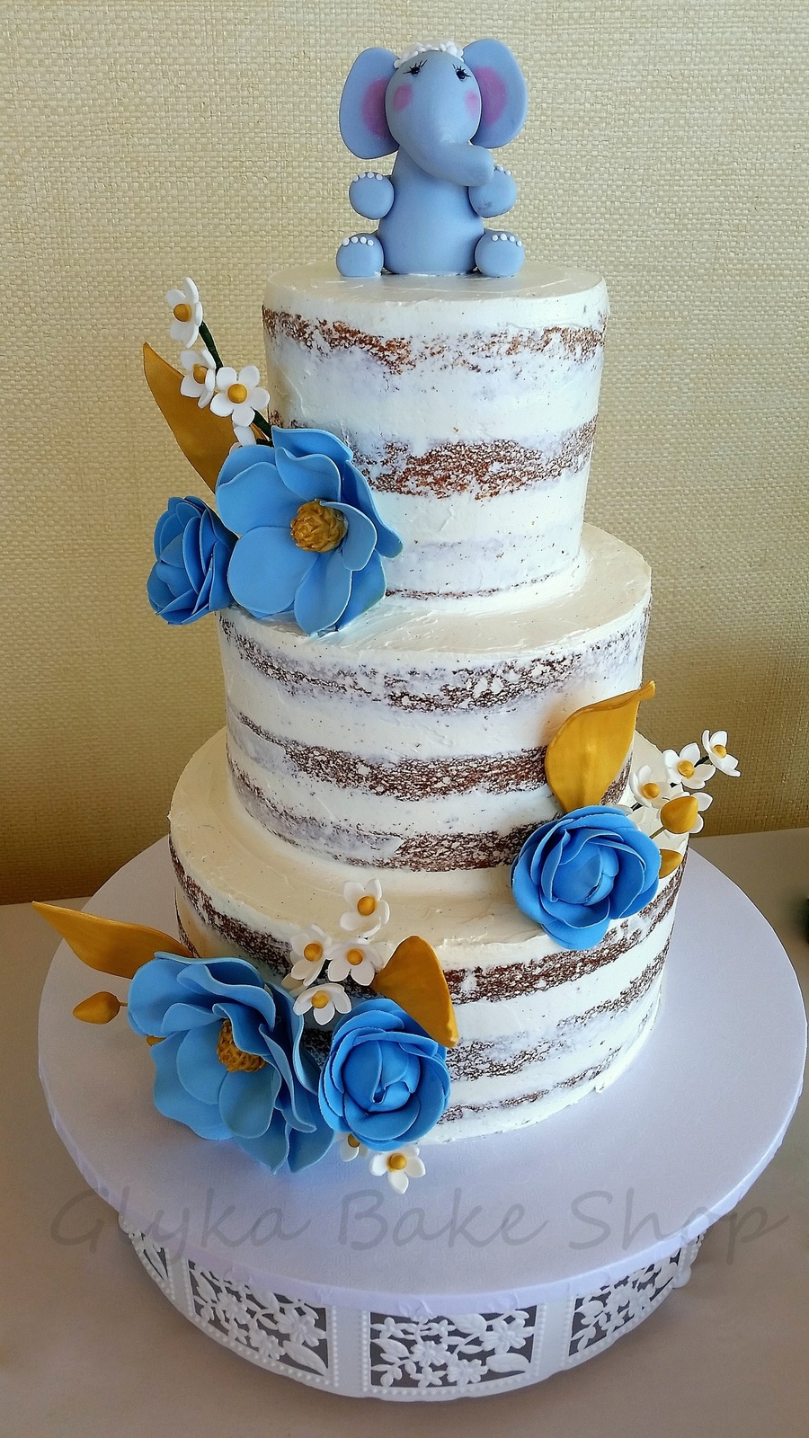 Naked Cake With Blue And Gold Florals - CakeCentral.com