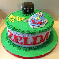 Legend Of Zelda Cake Chocolate cake with buttercream filling. Fondant covering, treasure chest is rice krispies, lettering and symbols are fondant/ gum paste.