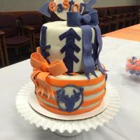 Blue And Orange Baby Shower Cake Baby shower cake with deer silhouettes and arrows.