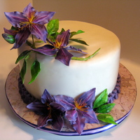 Purple Clematis For A Bridal Shower Cake The bride's favorite color is purple. I was concerned as purple is an unstable color, but I had no issues with it. The flowers are gum...