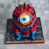 Spider Minion spider minion cake - hes red velvet on the inside and cream cheese icing :)