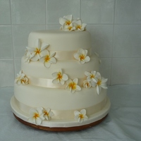 Frangipani Wedding Cake Fondant covered chocolate cake with sugarpaste flowers.