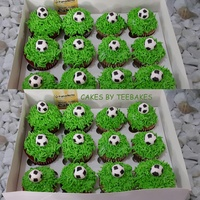 Soccer Themed Cupcakes Red velvet and chocolate cupcakes. Hand painted balls made from mexican paste on buttercream grass.
