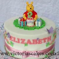 Winnie The Pooh Birthday Cake Winnie the Pooh Birthday cake for a little girl. For more pictures visit my facebook page https://www.facebook.com/victoriascakes.com.au