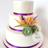 Bird Of Paradise And Succulents This wedding cake i made last weekend and it was so much fun! The bird of paradise is cute out by hand :).The couple wanted a personalized...