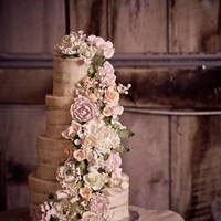 Romantic Rustic This naked cake is layers of wedding white (almond) cake with raspberry cream, covered in a super thin buttercream. The swag of gorgeous...