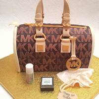 A Michael Kors Handbag Cake I made this cake last week. The bag is vanilla sponge covered with chocolate fondant. The MK logo is an edible image and I handcut each one...