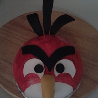 Angry Bird Birthday Cake Two layers of different cakes:Angry bird is a gluten free cake - white with fondant icing.Larger cake is chocolate butter cream icing.