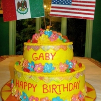 Mexican American Flag Floral Birthday tier cake frosted with whipped butter cream. Flowers made from modeling chocolate. flags were made from card stock.