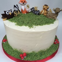 Woodland Animals 8inch, 3 layer chocolate cake. Filled with chocolate buttercream and caramel and covered in vanilla SMBC. Animals are handmade.