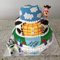 Toy Story Birthday Cake Three-tier Toy Story birthday cake with Buzz and Woody figures