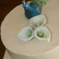 Peacock & Calla Lily Wedding Cake Bride requested a peacock & calla lilies on the cake.