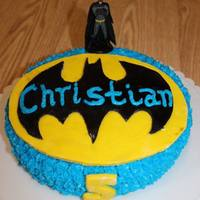 Batman Cake   Pretty basic cake with both fondant and buttercream. The cake was blue velvet which was convenient for the color scheme used.