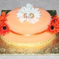 Orange Cream Bridal Party Cake The cake and icing are both orangesicle flavored. Even the fondant covering the outside was flavored as orangesicle.
