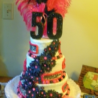 50Th Cake. Funny Sayings. Pink/black/white/daisies 3 tier. Frosted with whipped buttercream/ Daisies/false teeth and pearls made from modeling chocolate.