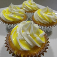 Lemon Cupcakes lemon pound cake cupcakes with cream cheese icing and lemon glaze.