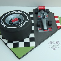 Formula One Cake   Smooth, Formula One tyre cake with a modelled gum paste car on a themed decorated board