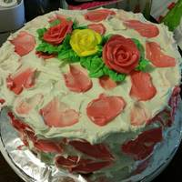 Rose Petal Cake Lemon cake with rasberry icing for a cake auction locally.