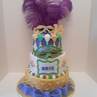 Mardi Gras Cake Handmade mardi gras mask on a buttercream cake with fondant accents.