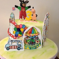 Bing And Flop At The Funfair Fondant covered Chocolate Ganache Buttercream cake made for my Great Niece, Maddie who is 3 years old today. She likes the characters Bing...