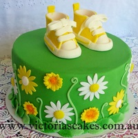 Yellow Booties Baby Shower Cake Yellow booties baby shower cake in green and yellow color theme as the mother to be did not know the sex of the baby. Please visit my...