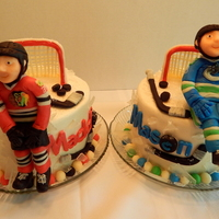 Canucks And Blackhawks Hockey Cakes  Maddon and Mason's hockey birthday cakes! 2, 6 inch round, 2 layer cakes, each with a candy clay version of the birthday boys! Maddon...